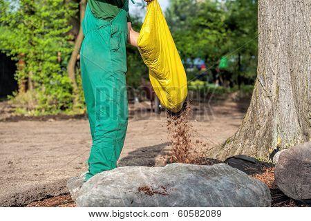 Gardener Spills Mulch On Barrier