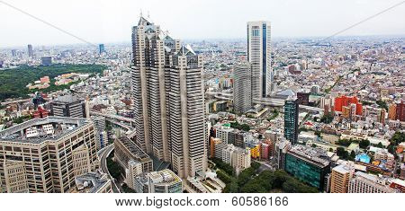 Aerial View Of Tokyo With Busy Roads And Office Buildings