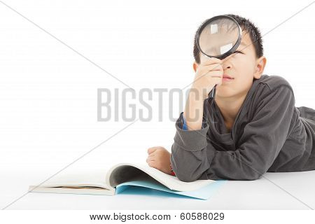 Happy Kid Is Holding Magnifying Glass To Explore