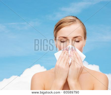 cosmetics, health and beauty concept - beautiful woman with paper tissue and closed eyes