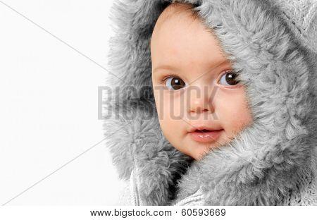 Baby girl wearing a winter fur coat.