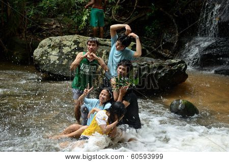 Children Playing Near A Waterfall
