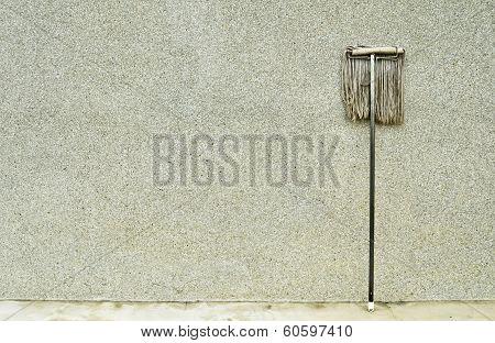 Swab Lean On The Pebble Wall