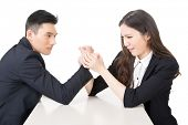 Arm wrestling challenge between a young business man and woman, closeup portrait on white background