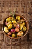 marinated Olives in bowls with moroccan  ornament on wood, shallow dof