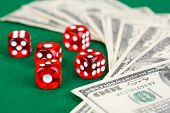 foto of dice  - Red dices and dollars on green background - JPG