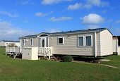 image of trailer park  - Side view of cream colored caravans in modern trailer park - JPG
