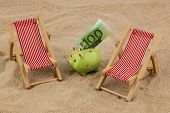 beach chair with euro currency on the sandy beach. symbolic photo for travel costs, vacation, holida