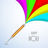 Indian festival Happy Holi celebrations with glossy colours splash coming out from a pichkari on blu