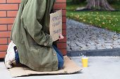image of beggars  - Beggar sitting on the corner asking for money and for food - JPG