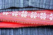 Pink flower in red black pattern background in Thai Sarong