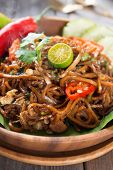 Indonesian and Malaysian cuisine, mi goreng or mee goreng mamak,  spicy fried noodles with wooden di