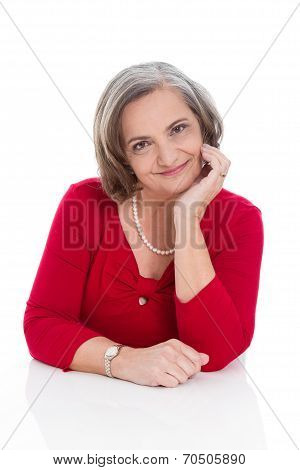 Portrait Of An Older Professional Business Woman In Red Isolated Over White.