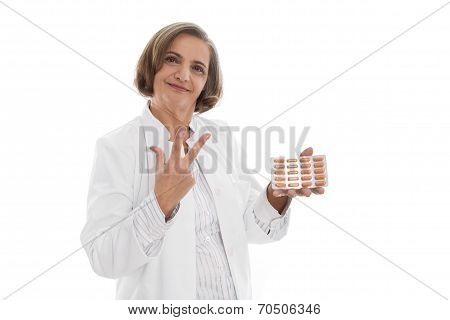 Portrait: Isolated Older Doctor Holding Medicine Making Three Fingers.
