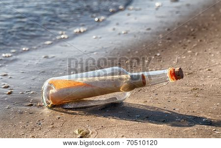 Letter Inside The Bottle On A Beach