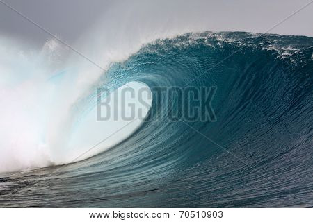 Big blue surfing wave