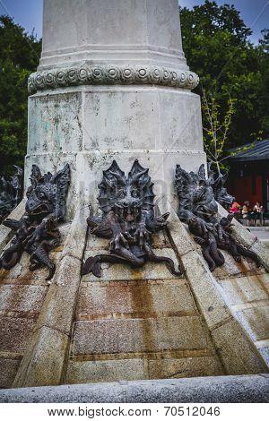 creature, devil figure, bronze sculpture with demonic gargoyles and monsters