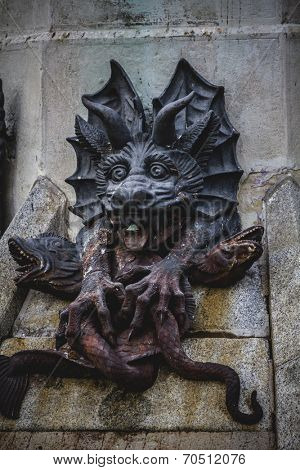 scary, devil figure, bronze sculpture with demonic gargoyles and monsters