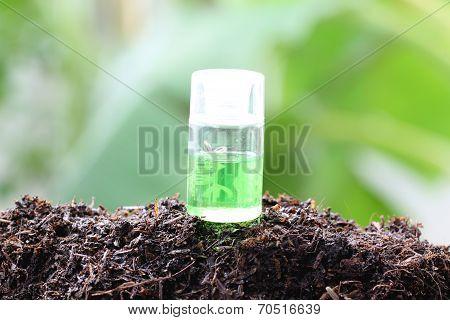 Perfume Bottle On Ground.