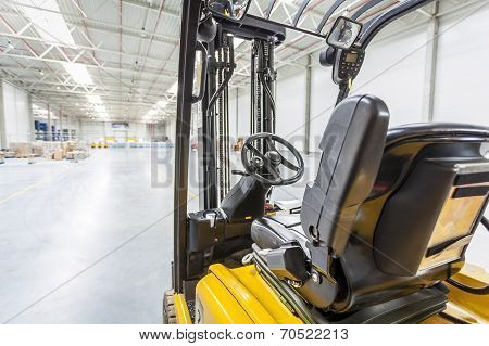 Forklift Truck Ready To Use In Modern Storehouse