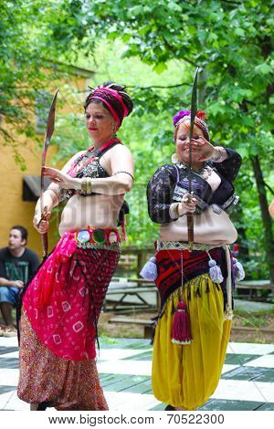 MUSKOGEE, OK - MAY 24: A woman dressed as Gypsy dances at the Oklahoma 19th annual Renaissance Festival on May 24, 2014 at the Castle of Muskogee in Muskogee, OK.