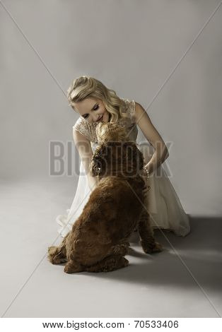 Beautiful blonde woman playing with cute dog