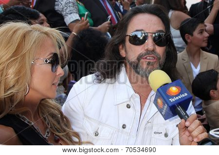 LOS ANGELES - AUG 21:  Cristian Solis, Marco Antonio Solis at the Los Tigres Del Norte Honored On The Hollywood Walk Of Fame at Live Nation Building on August 21, 2014 in Los Angeles, CA