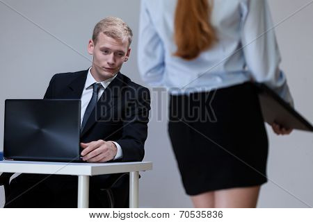 Man Observing Co-worker's Legs