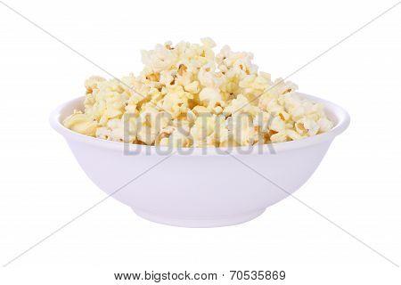 Popcorn in round bowl on white background.