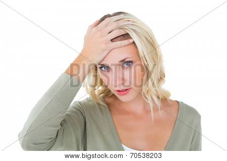 Confused young blonde looking at camera on white background