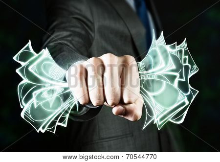 Close up of businessman hand clenching money banknotes in fist