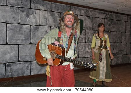 MUSKOGEE, OK - MAY 24: A husband and wife duo entertain the crowd at the Oklahoma 19th annual Renaissance Festival on May 24, 2014 at the Castle of Muskogee in Muskogee, OK.