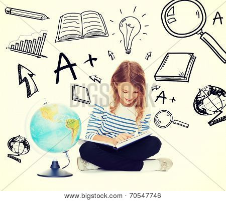 education and school concept - little student girl studying geography with globe and book