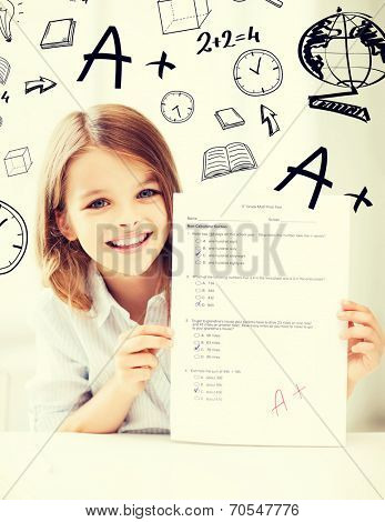 education and school concept - little student girl with test and A grade at school
