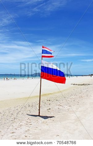 Flags On Koh Larn Beach. More Than 5,000 People Daily Are In Koh Larn During The High Season