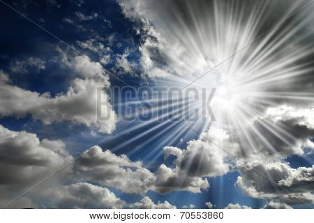 Blazing hot sun shining in blue sky with clouds