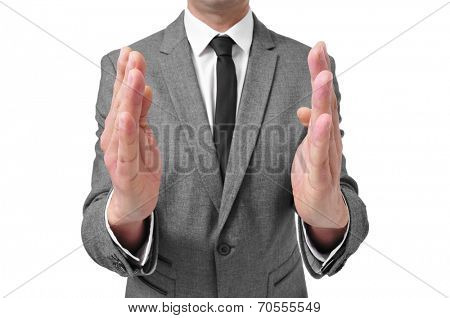 a man wearing a suit with his hands facing each other like showing the size of something
