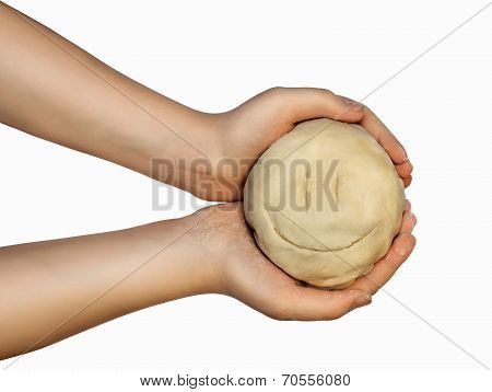 Smiling Face From The Dough For Baking In Hands Of A Little Girl