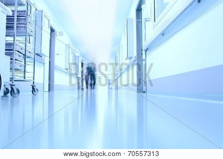 Silhouettes Of Doctors In The Corridor Of A Modern Hospital