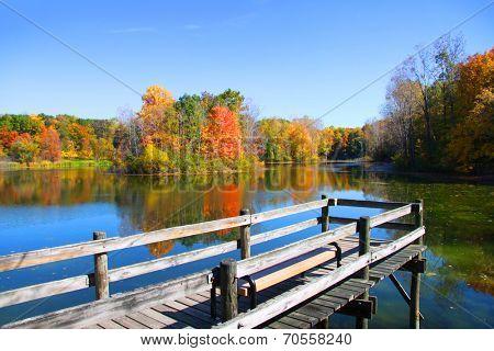 Board walk near the lake in autumn time