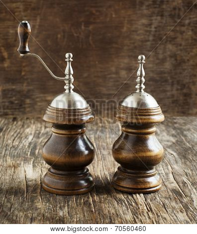 Vintage Wooden Salt And Pepper Shakers On Wooden Background