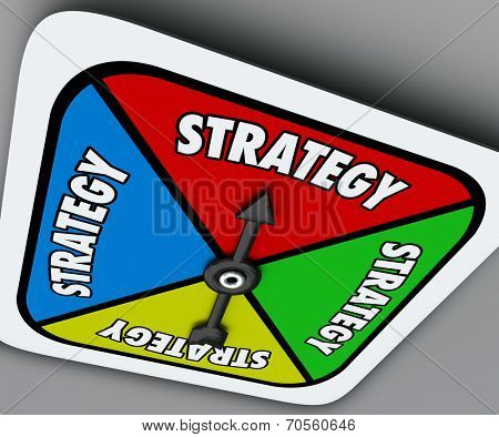 Strategy word on a board game spinner as your plan or turn to win the competition and achieve success in sports, business or life