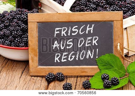 Slate Blackboard With The Germans Words: Frisch Aus Der Region