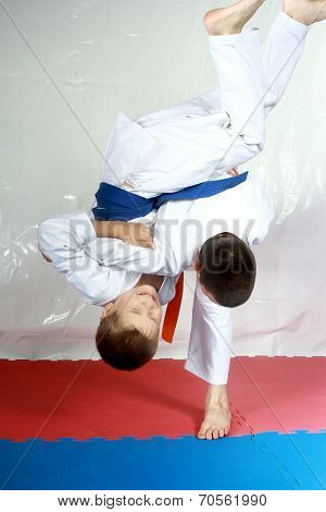 High throws are training two athletes in judogi