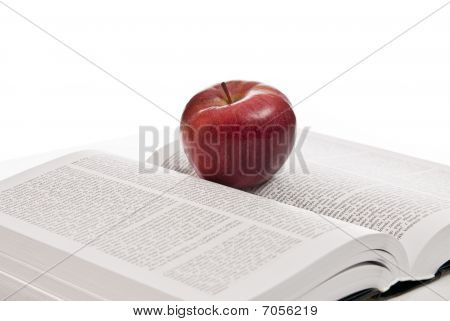 Opened Hefty Book And Fresh Red Apple
