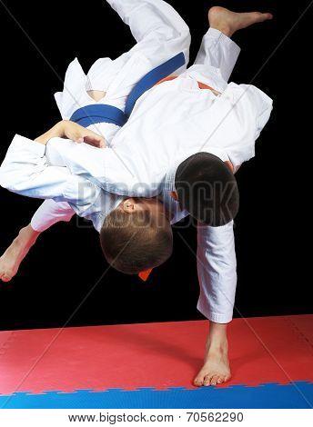 Very high throw in performing sportsman with orange belt