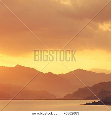calm evening landscape with lake and mountains