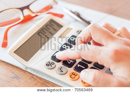 Businesswoman Working In Coffee Shop With Calculator