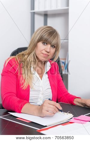 Woman Is Writing Into A File