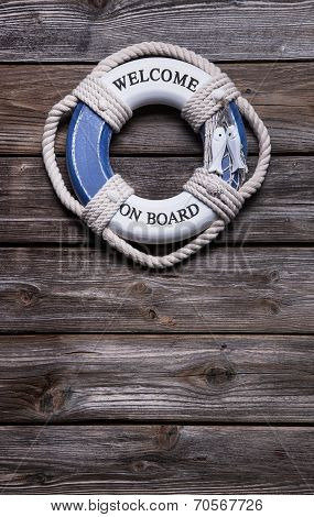 Maritime Decoration - Life Belt On Wooden Background - Concept